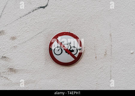 Road sign on wall. No bikes - Stock Photo