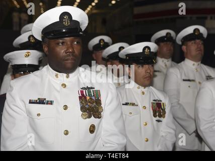 SAN DIEGO (April 3, 2019) The USS John P. Murtha (LPD 26) Chief's Mess observes the ship's change of command ceremony. USS John P. Murtha is the 10th San Antonio-class amphibious transport dock ship of the United States Navy and is named in honor of Congressman John Murtha of Pennsylvania and homeported in San Diego and is part of Naval Surface Forces and U.S. 3rd Fleet. - Stock Photo