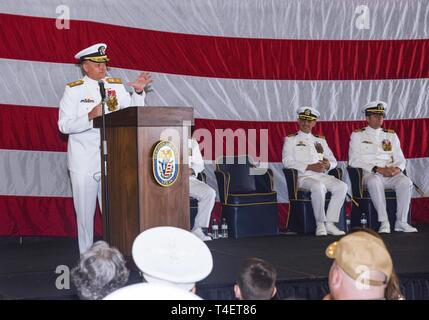 SAN DIEGO (April 3, 2019) Rear Adm. Joe Tynch III, commander, Logistics Group Western Pacific gives remarks during the USS John P. Murtha (LPD 26) change of command ceremony. USS John P. Murtha is the 10th San Antonio-class amphibious transport dock ship of the United States Navy and is named in honor of Congressman John Murtha of Pennsylvania and homeported in San Diego and is part of Naval Surface Forces and U.S. 3rd Fleet. - Stock Photo