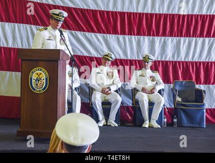 SAN DIEGO (April 3, 2019) Capt. Kevin Lane, commanding officer USS John P. Murtha (LPD 26) gives remarks during the ship's change of command ceremony. USS John P. Murtha is the 10th San Antonio-class amphibious transport dock ship of the United States Navy and is named in honor of Congressman John Murtha of Pennsylvania and homeported in San Diego and is part of Naval Surface Forces and U.S. 3rd Fleet. - Stock Photo