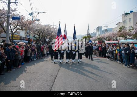 CHINHAE, Republic of Korea (April 05, 2019) Sailors assigned to Commander, Fleet Activities Chinhae (CFAC) march in the 57th annual Jinhae Gunhangje military port festival parade. The festival honors Admiral Yi Sun-sin, a great naval hero of Korea, whose victories still inform the fighting spirit of the ROK Navy. - Stock Photo