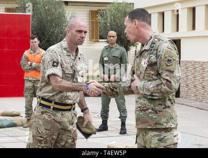 U.S. Army Brig. Gen. Eric Folkestad, the U.S. Army Africa deputy commanding general, shakes hands with British army Col. Jim Skelton MBE, BILLET, during a joint rehearsal of concept drill for eight nations participating in exercise African Lion 2019 at the Southern Zone Headquarters in Agadir, Morocco, March 30, 2019. African Lion 2019 is an annual, combined multilateral exercise designed to improve interoperability and mutual understanding of each nations' tactics, techniques and procedures while demonstrating the strong bond between the nations' militaries. This year's exercise brings togeth - Stock Photo