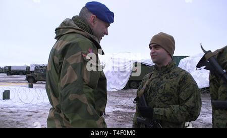 Brig. Gen. Lars S. Lervik, the commander of the Norwegian Brigade North, congratulates U.S. Marine Corps Sgt. Robert J. Susca, a forward observer with 2nd Air Naval Gunfire Liaison Company (ANGLICO), II Marine Expeditionary Force Information Group, for earning the Artic Service ribbon in Haparanda, Sweden, March 20, 2019. During exercise Northern Wind, Marines with 2nd ANGLICO were awarded for their time training in the Arctic Circle during Cold Weather Operations Training. This Cold Weather Operations Training is the entry level cold weather training for Norwegian soldiers. - Stock Photo