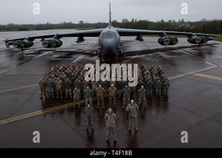 Airmen assigned to the 2nd Maintenance Group deployed from Barksdale Air Force  Base, La., pose for a photo during a U.S. Strategic Command Bomber Task Force  in Europe at RAF Fairford, April 4, 2019. BTF operations are developed to provide  training opportunities for U.S., allies and partners to operate together in joint environments. - Stock Photo