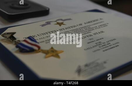 The first Silver Star Medal awarded to a Tactical Air Control Party operator for actions over the last seven years lays on a table before a presentation ceremony at the Mighty Eighth Air Force Museum, Pooler, Georgia, April 9, 2019. The SSM is the third-highest medal awarded for gallantry against an armed enemy of the U.S. in combat and was awarded to U.S. Air Force Tech. Sgt. Cam Kelsch, a Special Tactics Tactical Air Control Party operator with the 17th Special Tactics Squadron. Kelsch is credited with repeatedly exposing himself to enemy fire to save the life of a wounded teammate and contr - Stock Photo