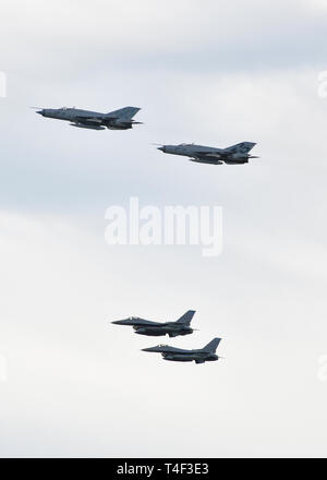 Two Minnesota Air National Guard F-16's and two Croatian military MiG-21s fly a four-ship formation above Zagreb International airport on April 6, 2019.  The event was held through the National Guard State Partnership Program between Croatia and the Minnesota National Guard.  The relationship was started in 1996 and the countries have conducted multiple engagements throughout the two decades.  The program has focused on strengthening several key military capabilities including cyber defense and security and defense support to civil authorities.  (Air National Guard Photo by Tech. Sgt. Lynette  - Stock Photo