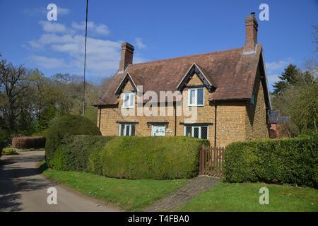 House in the Warwickshire village of Wormleighton captured in spring sunshine - Stock Photo