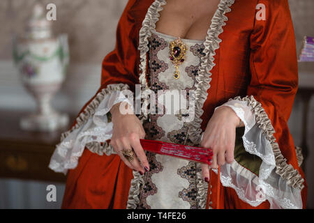 Retro style royal medieval ball - Majestic palace with gorgeous people dressed in king and queen's friends dresses with accessories such as fan and - Stock Photo