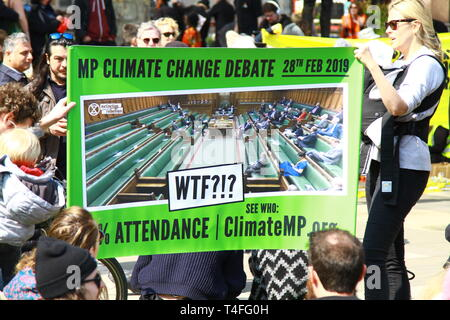 CLIMATE CHANGE DEBATE SIGN DEPICTING HOW FEW MEMBERS OF PARLIAMENT ATTENDED THE CLIMATE CHANGE DEBATE IN THE HOUSE OF COMMONS ON THE 28TH FEBRUARY 2019. EXTINCTION REBELLION DEMONSTRATION ON 15TH APRIL 2019 IN PARLIAMENT SQUARE, WESTMINSTER, LONDON, UK. - Stock Photo