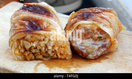 Home made food. Roasted  sarmi. Traditional meals with rice-stuffed cabbage leaves for Christmas Eve. - Stock Photo