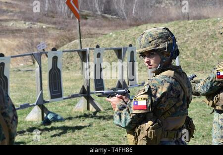 A Chilean cadet from the Bernardo O'Higgins Military School, Chile, takes part in an M9 pistol range in preparation for the 51st Sandhurst Military Skills Competition in West Point, New York, April 12-13. Sandhurst, a premier international military academy competition which began in 1967, is a two-day, approximately 30-mile course filled with individual and squad-based events designed to promote military excellence of future leaders across the world. This year, 49 teams from more than a dozen countries will participate in the competition, with two first-time teams competing from Denmark and Gr - Stock Photo
