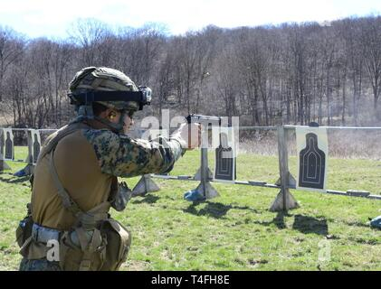 A Chilean army cadet from the Bernardo O'Higgins Military School shoots paper targets during an M9 pistol range at the U.S. Military Academy, West Point, New York, in preparation for the 51st Sandhurst Military Skills Competition, April 12-13. Sandhurst, a premier international military academy competition which began in 1967, is a two-day, approximately 30-mile course filled with individual and squad-based events designed to promote military excellence of future leaders across the world. This year, 49 teams from more than a dozen countries will participate in the competition, with two first-t - Stock Photo