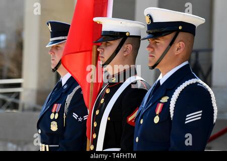 U.S. service members with the Joint Armed Forces Color Guard stand at attention while carrying the national flag of Austria during an Armed Forces Full Honor Cordon in honor of the Austrian Minister of Defense Mario Kunasek at the Pentagon's river entrance in Arlington, Va., April 10, 2019. The ceremony was hosted by the Acting, Secretary of Defense Patrick M. Shanahan. - Stock Photo