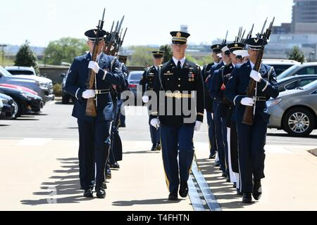 U.S. service members with the Joint Armed Forces Honor Guard march into position prior to an Armed Forces Full Honor Cordon in honor of the Austrian Minister of Defense Mario Kunasek at the Pentagon's river entrance in Arlington, Va., April 10, 2019. The ceremony was hosted by the Acting, Secretary of Defense Patrick M. Shanahan. - Stock Photo