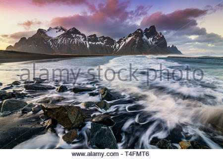 Sunset at Vestrahorn Mountain and Stokksnes beach. Vestrahorn is a popular tourist attraction along the ring road in Eastern Iceland. - Stock Photo