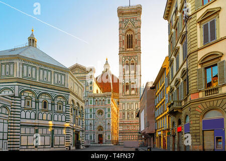Piazza del Duomo and cathedral of Santa Maria del Fiore in Florence, Italy in the sunrise - Stock Photo