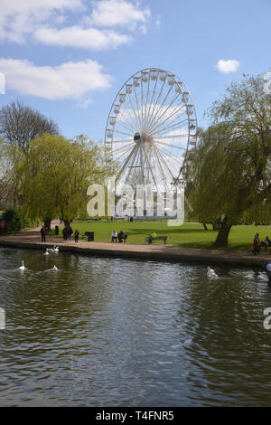 A big wheel or ferris wheel has been constructed on the bank of the River Avon, Stratford upon Avon, Warwickshire - Stock Photo
