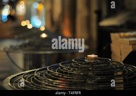 Paris, France - November 7, 2013: Candles in Notre Dame de Paris - Stock Photo