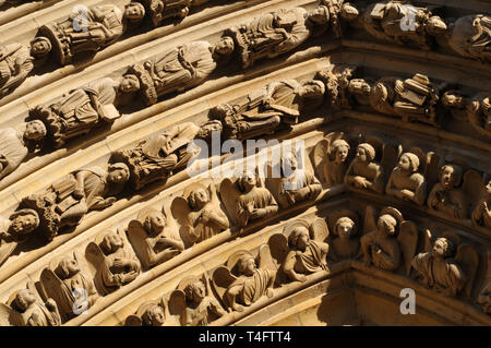 Detail of rows of sculptures above a portal on the west facade of Notre-Dame de Paris Cathedral. Construction on the Gothic landmark began in 1163. - Stock Photo