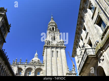 Santiago de Compostela, Spain. Cathedral, Clock Tower from Plaza de las Platerias with blue sky. - Stock Photo