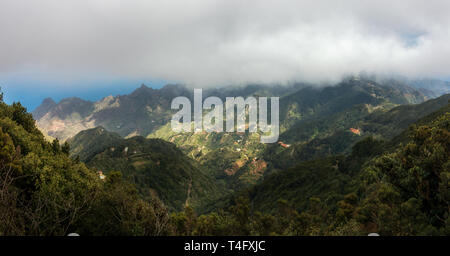 Stunning mountain views high up under the cloud from Pico Ingles Mirador in the Parque Rural de Anaga park, TF-12 Tenerife, Spain - Stock Photo