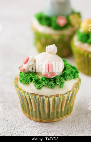 Easter background with beautiful cupcakes - Stock Photo