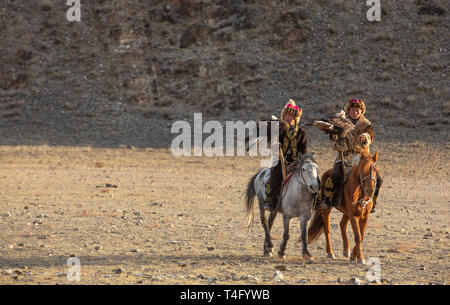 bayan Ulgii, Mongolia, 3rd October 2015: kazakh eagle hunters in a landscape of Mongolia - Stock Photo