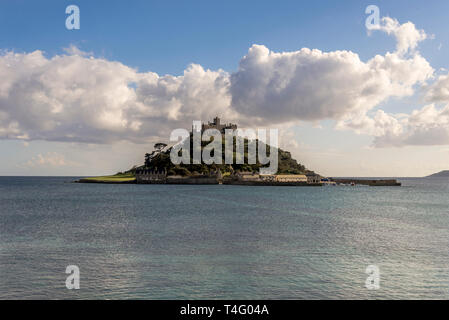 The beautiful & picturesque island of St.Michaels mount Marazion Cornwall UK Europe in beautiful sunshine & blue skies with puffy white clouds . - Stock Photo