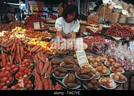 Thailand. Bangkok. Chatuchak Park weekend market. Woman working on vegetables stall. - Stock Photo