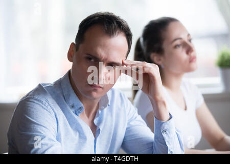 Man and woman stubbornly not talking having fight at home - Stock Photo