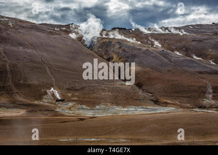 Namafjall mountain seen from Hverir boiling mud area also called Hverarond near Reykjahlid town in the north of Iceland - Stock Photo