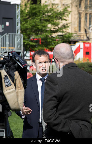 Westminster, London, UK. 11 April 2019. Alun Cairns, Secretary of State for Wales, gives a number of interviews to the media in College Green opposite - Stock Photo