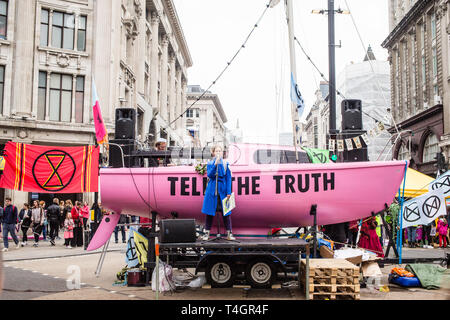 London UK 16th Apr 2019  A Woman speaks in front of boat  with'Tell The Truth' written on  Oxford Street.