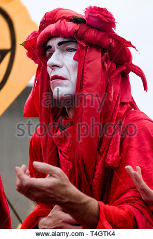 Extinction Rebellion environmental activists occupy Waterloo Bridge, London. Performance group Invisible Circus participate in the protest. - Stock Photo