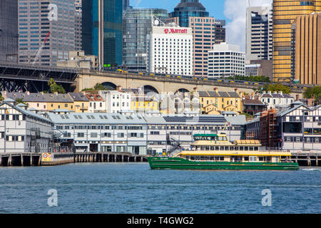 Sydney ferry may gibbs passes in front of city centre office buildings,Sydney,Australia - Stock Photo