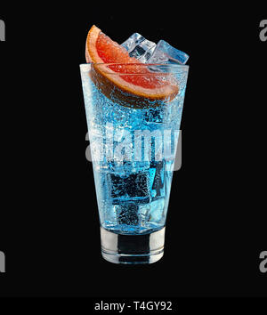 Cocktail Blue Lagoon in a high glass close-up, isolated on a black background - Stock Photo