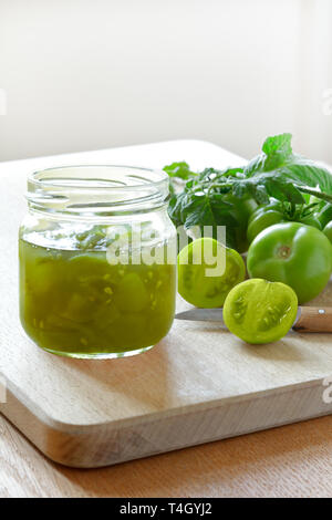 Jam or chutney in a glass jar made of green tomatoes, home canning concept - Stock Photo