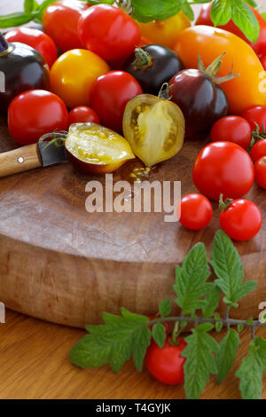 A colorful selection of heirloom tomato cultivars, food diversity concept - Stock Photo