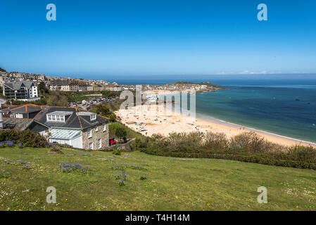 Looking down at the panoramic view of the tourist destination of St.ives Cornwall UK Europe on a beautiful warm calm sunny day . - Stock Photo