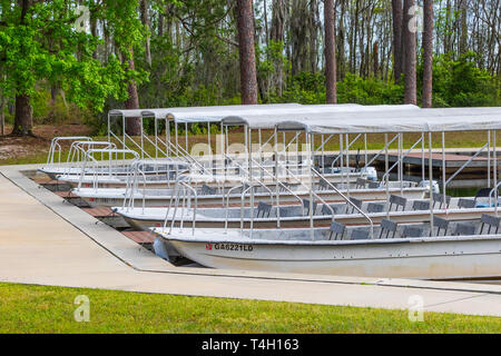 Okefenokee Swamp, Folkston, GA, USA-3/29/19: Tourist skiffs docked at the canal at eastern entrance to the swamp. - Stock Photo