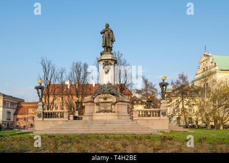 Warsaw, Poland. April 2019.   A view  of the monument of Adam Mickiewicz in a garden in Warsaw - Stock Photo