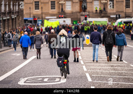 Edinburgh, UK. 16th April 2019. Protesters on North Bridge, Edinburgh, take part in the XR Climate Emergency Roadblock Demonstration. - Stock Photo