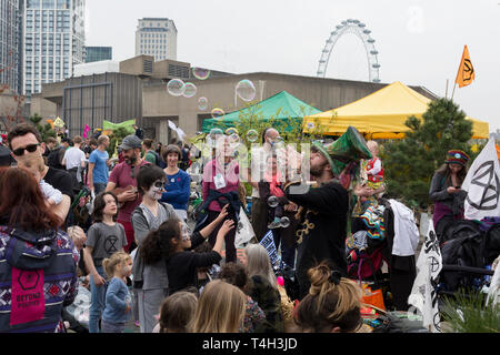 Climate Change activists with Extinction Rebellion campaign for a better future for planet Earth after blocking Waterloo Bridge and as part of a multi-location 5-day Easter protest around the capital, on 16th April 2019, in London, England. - Stock Photo