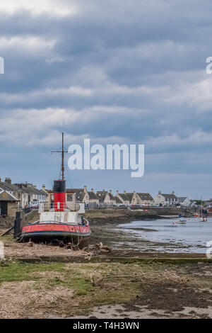 Irvine Harbour North Ayrshire Scotland and the old Science Museum Bridge in the far distance while the harbour is at low tide. - Stock Photo