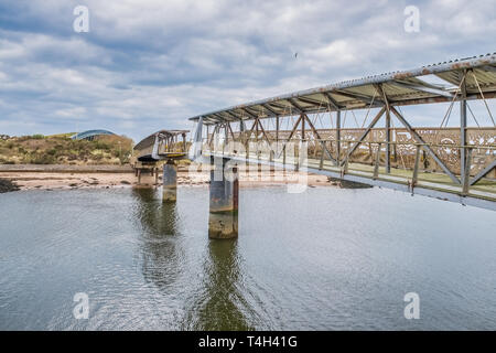 Irvine, Scotland, UK - April 14, 2019: Irvine Harbour North Ayrshire Scotland and the old Science Museum Bridge with its art work soon to be redevelop - Stock Photo
