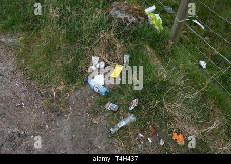 Troon, Scotland, UK - April 14, 2019: Roadside dumping and polluting on one of Scotlands most beautiful hillside landscapes near Troon on the West Coa - Stock Photo