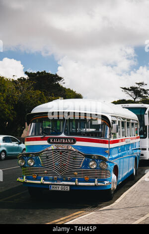 MDINA, MALTA - SEPTEMBER, 15 2018: A typical colorful old Maltese British bus from the 60s at the street, public transport in Malta - Stock Photo