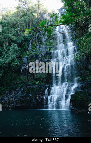 Salto Cristal cascading waterfalls secluded in a rainforest, surrounded by exuberant vegetation, Paraguari Department, Paraguay - Stock Photo