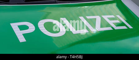 CENTRAL STATIONS, MUNICH, APRIL 6, 2019: green german police print on a parking car - Stock Photo