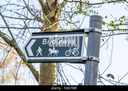 Close up of Highways public 'Bridleway' sign on post in rural, countryside setting. Public right of way for all on on foot, on horseback & on bicycles. - Stock Photo